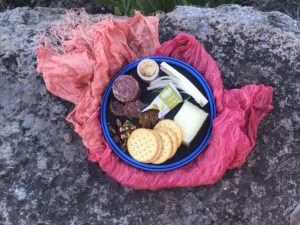 A meat and cheese plate made up of common backcountry foods